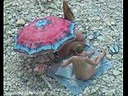 Hidden camera blowjob on the beach