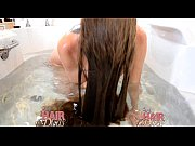 longhaired blonde milf dunking head in water