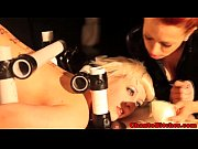 Spreadeagle sub restrained by femdom dom
