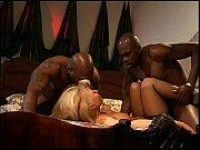 Picture Two gigantic black boners sharing blonde cha...