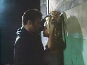 Pamela Anderson against wall sex scene