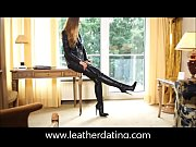 Brunette in leather jacket and thyhigh leather ...