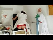 Sexy redhead nurse in latex uniform gets nasty