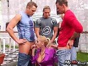 Blonde cutie, Julie Silver is walking outdoors wh