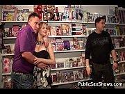 Busty stripper looks hot at sex shop