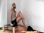 Hot Mistress with long legs gives handjob in gl...