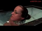 Bondaged girl pushed under the water tits rubbed