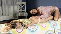 Two lesbian beauties pleasure each other on the...