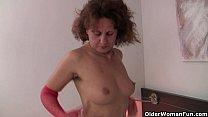 Hairy grandma Inge in red stockings is fingerin...