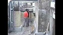 trabajo del azotea la en Cogiendo