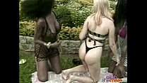 Horny blonde fucked by two shemales outdoors