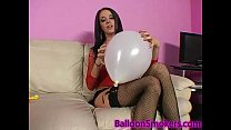 teen blows up balloons in fishnet top and high heels