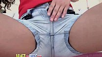 Pissing through her tight denim jeans
