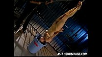 Skinny Japanese chick tied up and drenched in h...