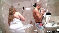 Big belly girlfriend is banged in the bathroom porn videos