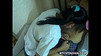Asian lesbians are sucking and kissing on each others titties porn videos