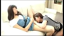 asian girl in stripped top licking fingering other girls pussy on the couch