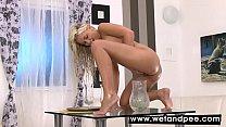 Beautiful blonde showering herself in pee