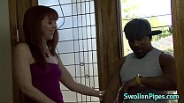 Sexy redhead swallows up some black dick