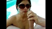 sucking cock with sunglasses pool side