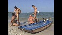 Hot gay threesome fucking on the beach