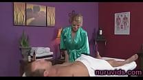 Busty blonde masseuse sucking cock