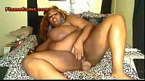 Ebony BBW amateur with huge tits fills her puss...