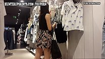 Beautiful young woman in mini-skirt caught in t...