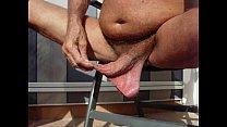 long foreskin   low hanging balls.