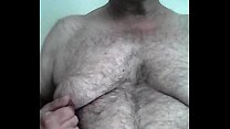 Watching TV playing with my nipples