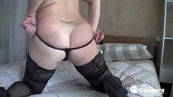 Big titty milf in stockings and heels fingers her pussy