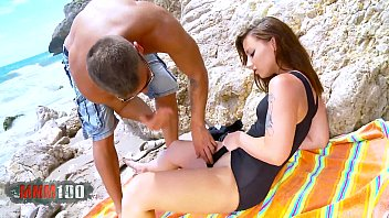 Amazing young brunette gets double penetration on the beach