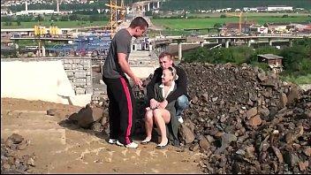 Very cute little teen girl public gang bang threesom at a construction..