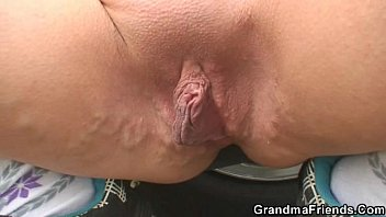Blond granny has threesome outdoors