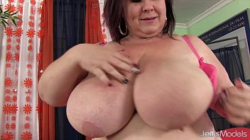Huge boobed mom stuffs herself with a cucumber