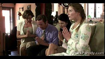 Religious family demonstrate their faith to a lucky businessman