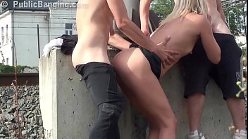 A cute milf facialized in public threesome with 2 guys by a railway st..