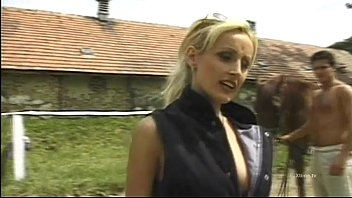 Blonde slut gives blowjobs on a stable...