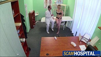 Blonde horny patient gets fucked by her doctor in the examining table