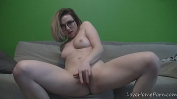 blonde-with-glasses-strips-her-clothes-and-masturbates