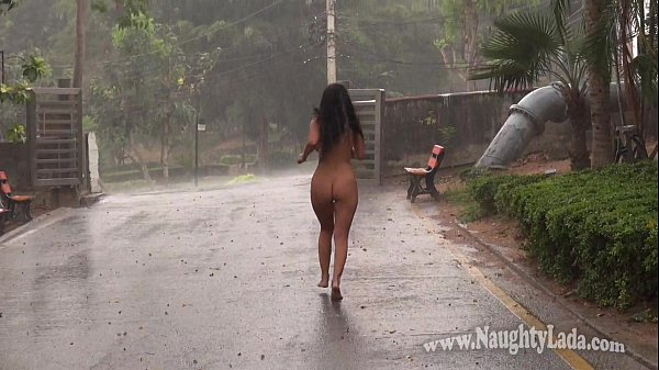 Naked asian girl in the rain