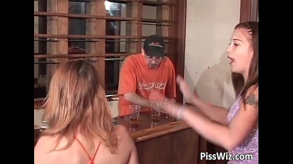 Young slutty babe pisses into a glass...