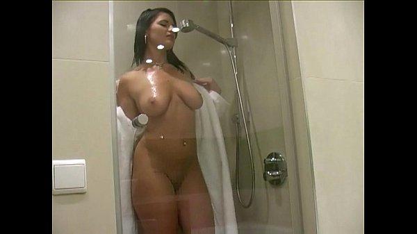 woman showering naked masturbating