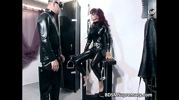 Redhead bitch in latex cloth gets pussy...