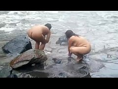2992477 two indian mature womens bathing in river naked