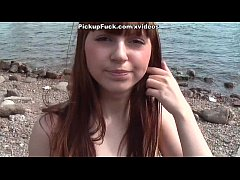 red-haired girl fucked on the beach in front of...