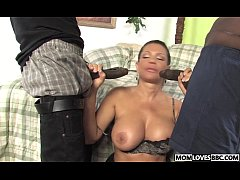 Teri Weigel takes two black cocks in front of h...