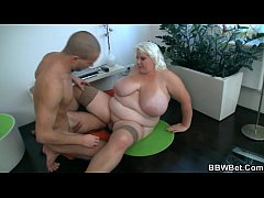 Fat blonde gives cool titjob