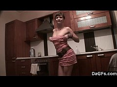 Freckled-face baby plays with her dildo on kitc...