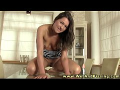 watersports loving babe rolls in her pee